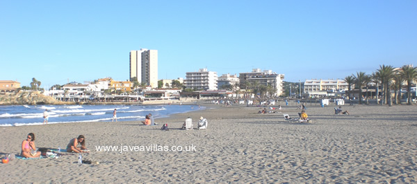 sunbathing on Javea's arenal beach in late September
