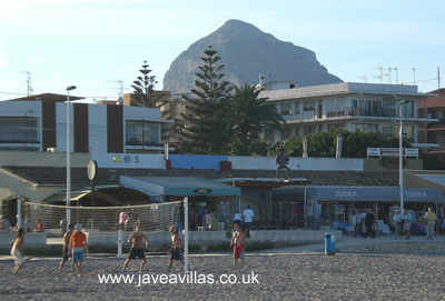 Playing volleyball as light fades on Javea Arenal Beach with the Montgo in the background - click for spectacular pictures of Javea
