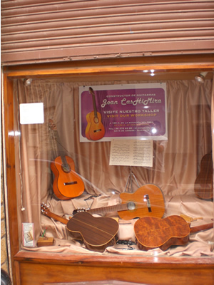 The Guitar Factory's shop window on the street.