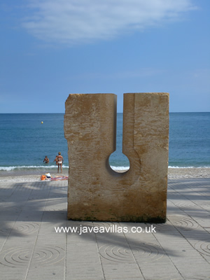 Javea Port sculptures are changed every year.  This one is made using the local tosca stone.