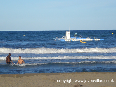 Swimming at Javea Arenal Beach